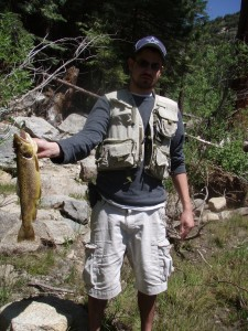 Chris Templin proudly displaying his big Wild Brown Trout